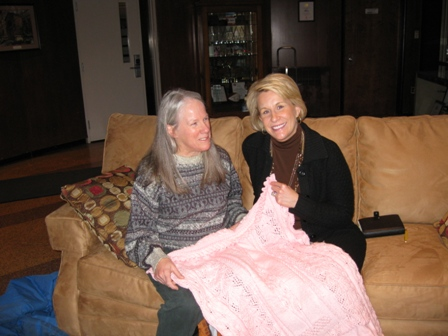 Donna presents a hand-made pink afghan to Scranton-area TV news anchor Lyndall Stout in honor of her work promoting breast self-exam: photo by Rich Hill