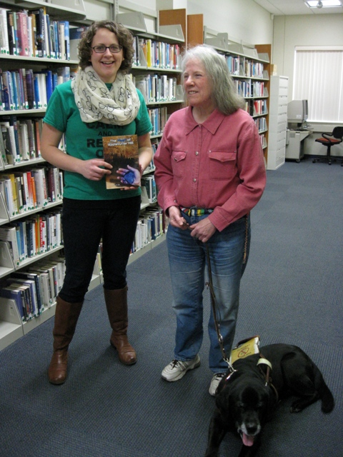 Donna donates The Heart of Applebutter Hill to Abington Community Library Dir. of Youth Services Laura Garloski: photo by Rich Hill.
