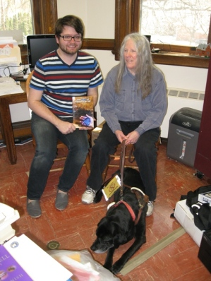 Donnna - with her black Lab guide dog, Hunter - donates The Heart of Applebutter Hill to Dir. Jesse Johnson of the Towanda Public Library: photo by Rich Hill.