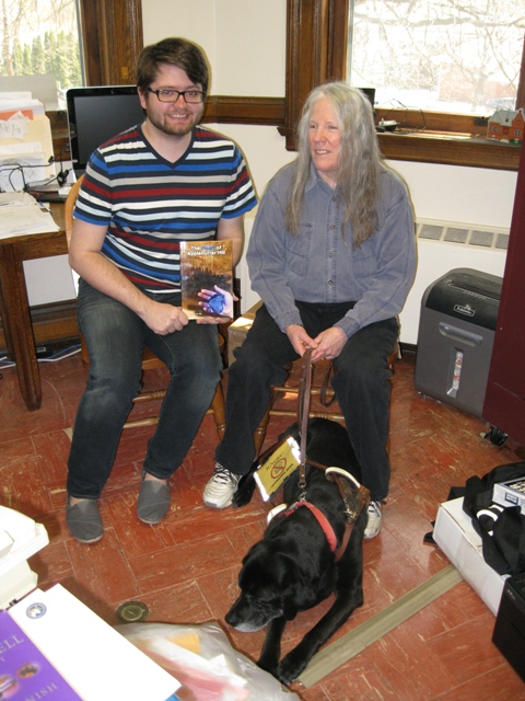 Donna W. Hill  - with her black Lab guide dog, Hunter - donates The Heart of Applebutter Hill to Dir. Jesse Johnson of the Towanda Public Library: photo by Rich Hill.
