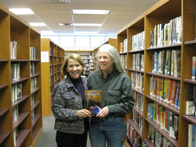 Donna presents a copy of The Heart of Applebutter Hill to Dir. Kristin Smith Gary at the Wyoming County Public Library in tunkhannock, Pa: photo by Rich Hill