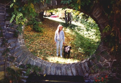 Donna & Curly Connor in opening of stone wall at Grey Towers National Historical Site (Milford, PA), mid '90s: photo by Rich Hill.