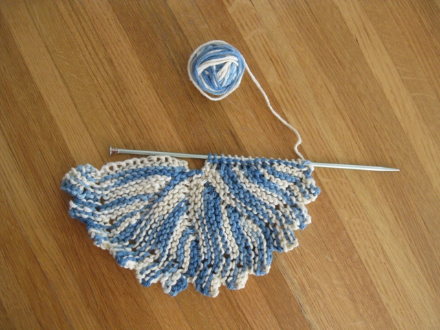 Round Dishcloth on Needles Shows Curve of Short-row Knitting: photo by Rich Hill.
