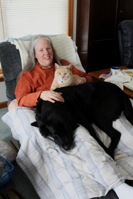 3 Lazy Boys  & 1 Lazy Girl: shows Donna, black Lab guide dog Hunter & rescued orange tabby Goofus in a Lazy Boy recliner: photo by Rich Hill.