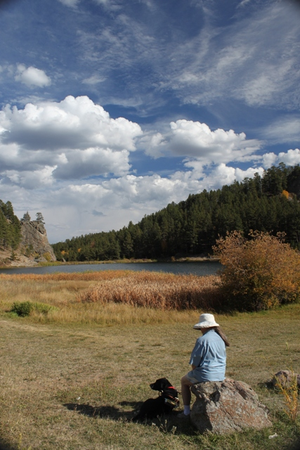 Donna & Hunter rest by a lake in South Dakota several years ago: photo by Rich Hill.