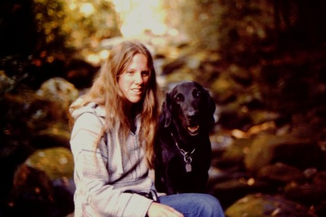 Donna Sitting with her first guide dog Simba (a black Lab) in Great Smokies National Park in '81: photo by Rich Hill