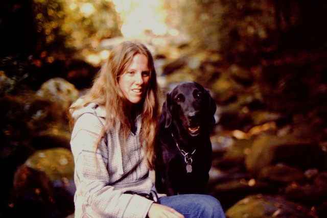 Donna Sitting with her first guide dog Simba (a black Lab) in Great Smokies National Park in '81: photo by Rich Hill.